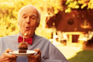Senior Man Blowing out Birthday Candle