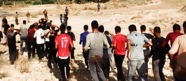 This image posted on a militant website on Saturday, June 14, 2014, which has been verified and is consistent with other AP reporting, appears to show militants from the al-Qaida-inspired Islamic State of Iraq and the Levant (ISIL) leading captured Iraqi soldiers wearing plain clothes to an open field moments before shooting them in Tikrit, Iraq. The Islamic militant group that seized much of northern Iraq has posted photos that appear to show its fighters shooting dead dozens of captured Iraqi soldiers in a province north of the capital Baghdad. Iraq's top military spokesman Lt. Gen. Qassim al-Moussawi confirmed the photos? authenticity on Sunday and said he was aware of cases of mass murder of Iraqi soldiers. (AP Photo via militant website)