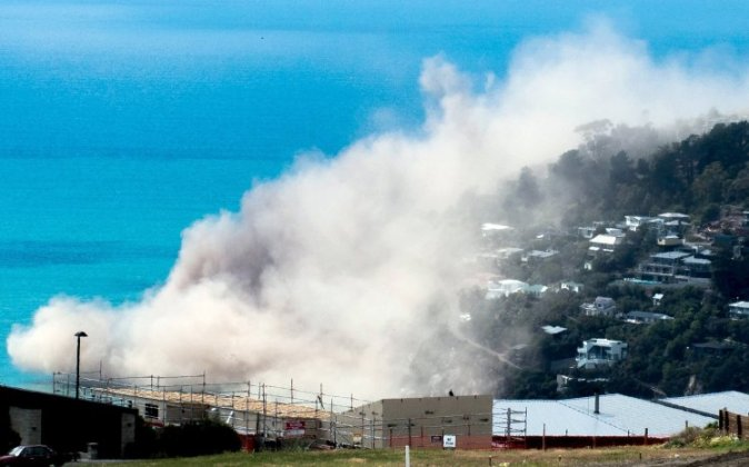 Dust and debris rise above houses after a cliff collapsed due to an earthquake on the Whitewash Head area, located above Scarborough Beach in the suburb of Sumner, Christchurch, New Zealand, February 14, 2016. A strong 5.7 magnitude earthquake struck near Christchurch in New Zealand on Sunday, causing cliffs to collapse into the sea but no major damage to the city, which was devastated by a 2011 quake which killed nearly 200 people.       REUTERS/Richard Loffhagen/Handout via ReutersATTENTION EDITORS - THIS PICTURE WAS PROVIDED BY A THIRD PARTY. REUTERS IS UNABLE TO INDEPENDENTLY VERIFY THE AUTHENTICITY, CONTENT, LOCATION OR DATE OF THIS IMAGE. THIS PICTURE WAS PROCESSED BY REUTERS TO ENHANCE QUALITY. AN UNPROCESSED VERSION WILL BE PROVIDED SEPARATELY. FOR EDITORIAL USE ONLY. NOT FOR SALE FOR MARKETING OR ADVERTISING CAMPAIGNS. FOR EDITORIAL USE ONLY. NO RESALES. NO ARCHIVE.      TPX IMAGES OF THE DAY
